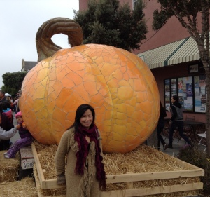 Lisa and the world's largest pumpkin sculpture. Photo by Randy Bales.